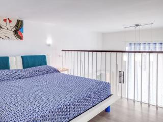 an elegant spiral staircase, leading to the first double bedroom with a queen sized double bed