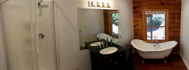 Master bath features a claw-foot tub and a separate walk-in shower.