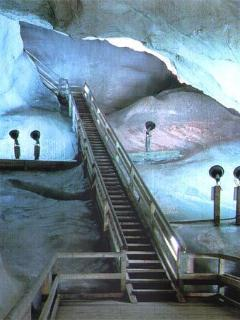 25 mins drive SE. UNESCO - Dobsinka Ice Caves,  A great place to explore in the heat of summer.