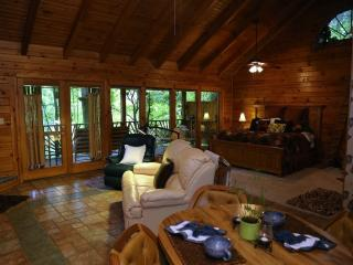 Discount this week and next. Awesome cabin. Listen to the river run.  Sleeps 2.