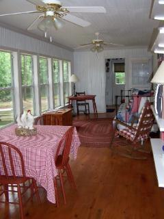The sunroom runs the length of the house and overlooks the backyard and lake.