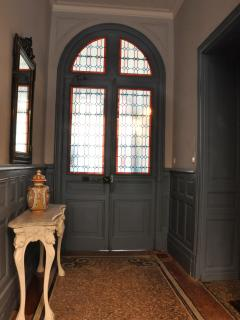 Private, secure street access into this marble mosaic & leaded stained glass oasis