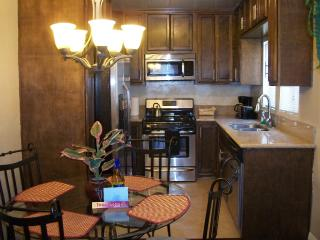 Kitchen with granite counters, stainless appliances including dishwasher.