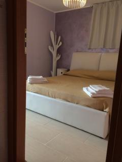bedroom in terrace with double bed,bathroom inside, air-conditioning and heating