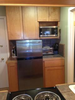 Stainless fridge, microwave, coffee maker, toaster oven