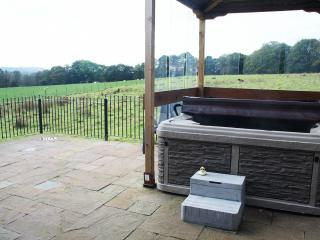 private hot tub with stunning views,soak away those aches and pains ,sipping a glass of prosecco