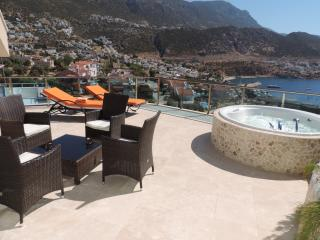 Seating area on roof terrace with view over Kalkan town and bay.