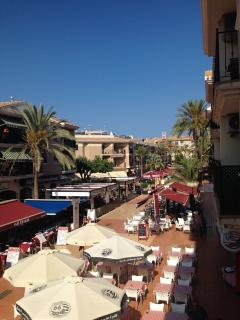 View from terrace overlooking the square towards the beach less than 5 min walk