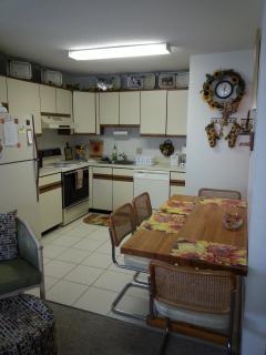 Open concept, sunny Sunflower themed kitchen