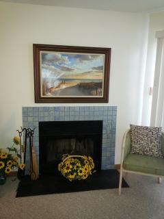 Woodburning fireplace in living room, facing the Bay