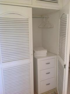 Full wardrobe outside of bathroom