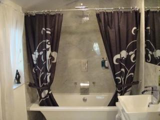 Ensuite bathroom with Egyptian cotton towels, roll top bath, water fall taps and rain shower
