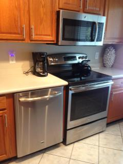 Stainless steel appliances: built in microwave, stove and dishwasher