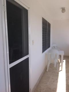 Your screened front door and balcony. All windows have screens.