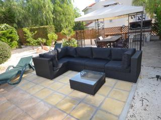 Sofa overlooking the pool ideal for a drink and chill