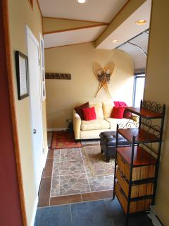 2nd living area w/full sofa sleeper: teens/kids love this cozy area w/game and book cabinet!