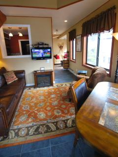 Leather sofa sleeper, flatscreen TV, chenille chair and pub style table and chairs