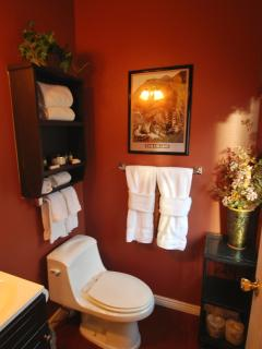 Private luxurious half bath with fluffy towels and signature lotions