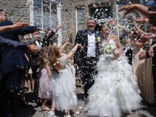 A wonderful moment on the steps, the happy bride and groom.