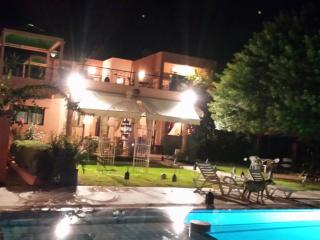 By the pool at night at Samadia