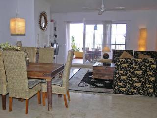 lounge to balcony..open log-fire, aircon, elec heating, WIFI, internet TV, fans..views