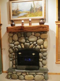 Warm up beside the cozy fireplace (with just the flip of a switch)!