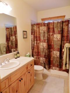 The charming tiled 2nd bath.