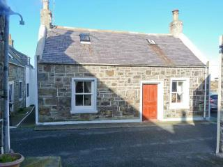 34 LOW SHORE, former fisherman's cottage, woodburner, sea views, in Whitehills,