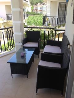 Spacious balcony leading from twin bedroom with pool view