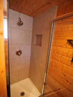 Shower in bathroom on upper level