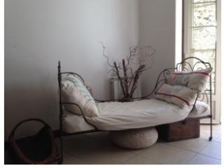 Daybed in the living room by the courtyard, perfect for a snooze