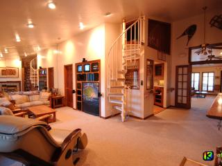 Living room, with entertainment center, massage chair. (stairs to optional loft)