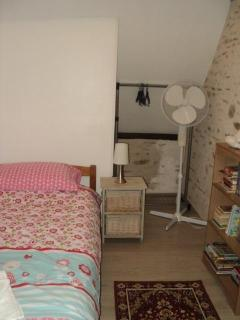 Twin bedroom, with clothes rail, bedside tables and touch lamps, tv and video player,