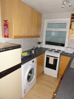 Fully equipped kitchen - tea, coffee, sugar, washing up liquid, tea towels, dish cloth provided