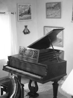 A well-tuned grand piano awaits nimble fingers in La Tuilerie...  for a concert  or a sing-along!