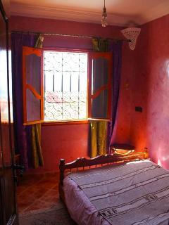 Traditional simply furnished double bedroom