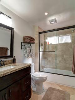Bath 1 | Symphony of wood & stone. Shower/ tub combo. Heated floors. Ample towels/ toiletries (main)
