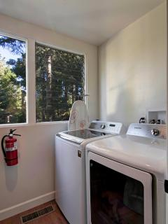 Laundry | Located off kitchen. Samsung large capacity W/D. Iron, laundry & cleaning supplies (main)