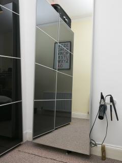 Bedroom 1 Vanity Mirror, hairdryer and GHD straighteners.