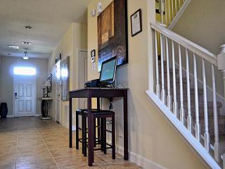 spacious hallway with handy PC workstation and WiFi printer