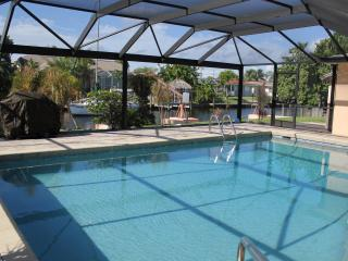 Canal Front Home with Heated Pool, Bikes, PingPong, Cape Coral