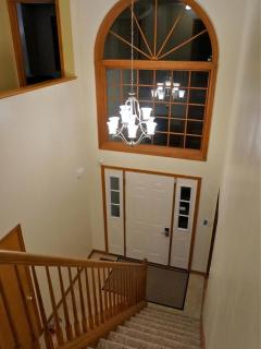 Center colonial home featuring a 2 story foyer entrance
