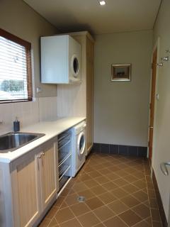 Laundry and half bathroom