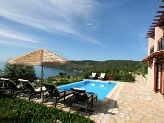 Seafront luxury villa EVA 2 floors(8+2),private pool, 30m from the sea area, Vasilikí
