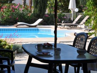 Relax by the pool in beautiful landscaped gardens