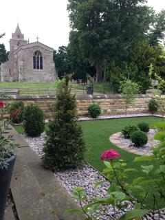 Front garden view to 11th Century Church in Hambleton