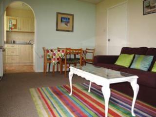 Living room with door to kitchen