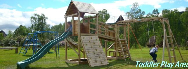 Toddler play area with low level assault course and huge lawn for games.