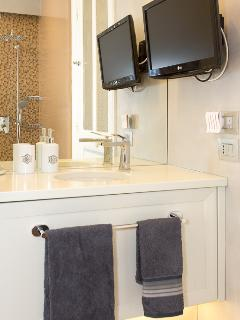 Shower room and TV from 2nd bedroom