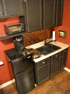 Kitchenette area with refrigerator/freezer, toaster oven, Keurig & stove-top, (microwave not shown)